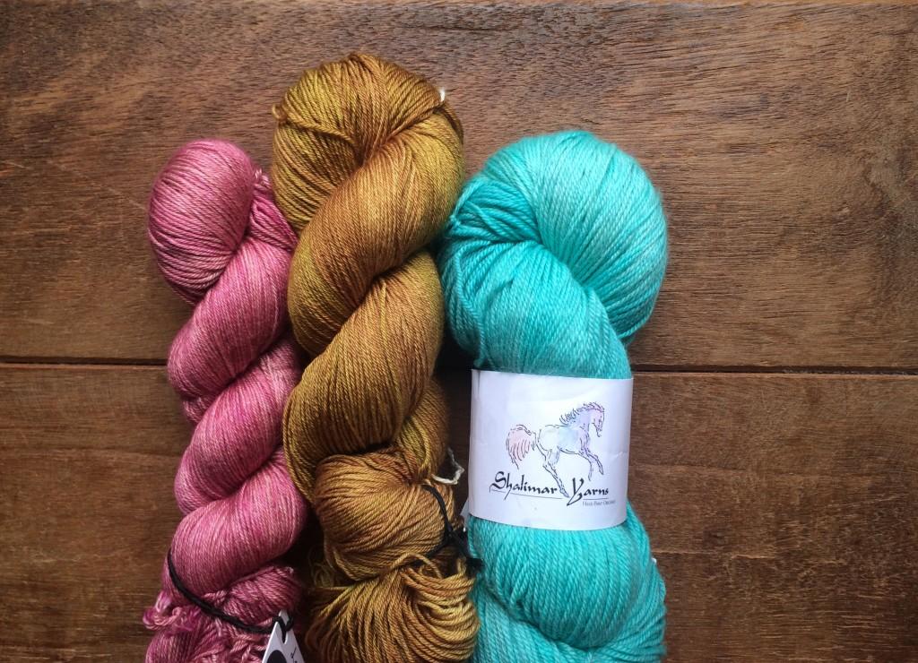 Kismet Refuge in Lady Slipper, DyeforYarn Merino Silk in Golden Beehive, Shalimar Breathless in Seaglass. Loop, London
