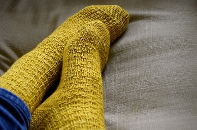 One of Rachel's patterns the 'Reasons to be Cheerful' socks - Image copyright of Rachel Atkinson