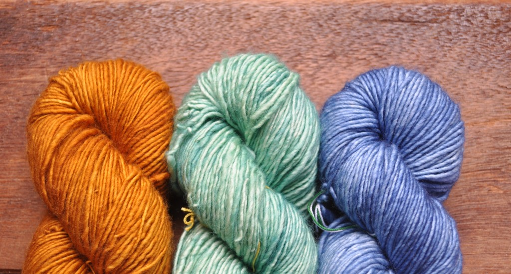Madelinetosh Merino DK (L-R) Glazed Pecan, Courbets Green, Betty Drapers Blues.