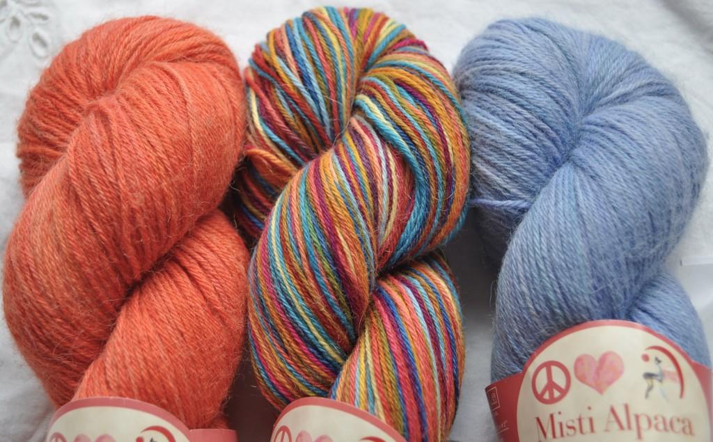 Misti Sock Yarn - (L-R) T40 Salmon, Hs58 Corked, T35 Skyling