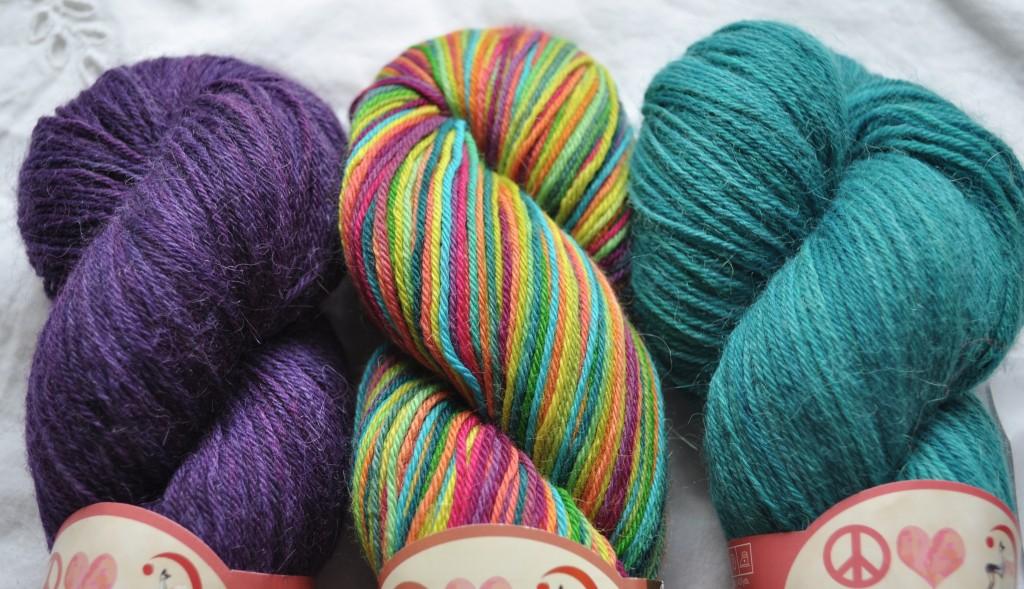 Misti Sock Yarn - (L-R) TF01 Purple Rain, HS56 Edible Brights, TF33 Bird Soded.